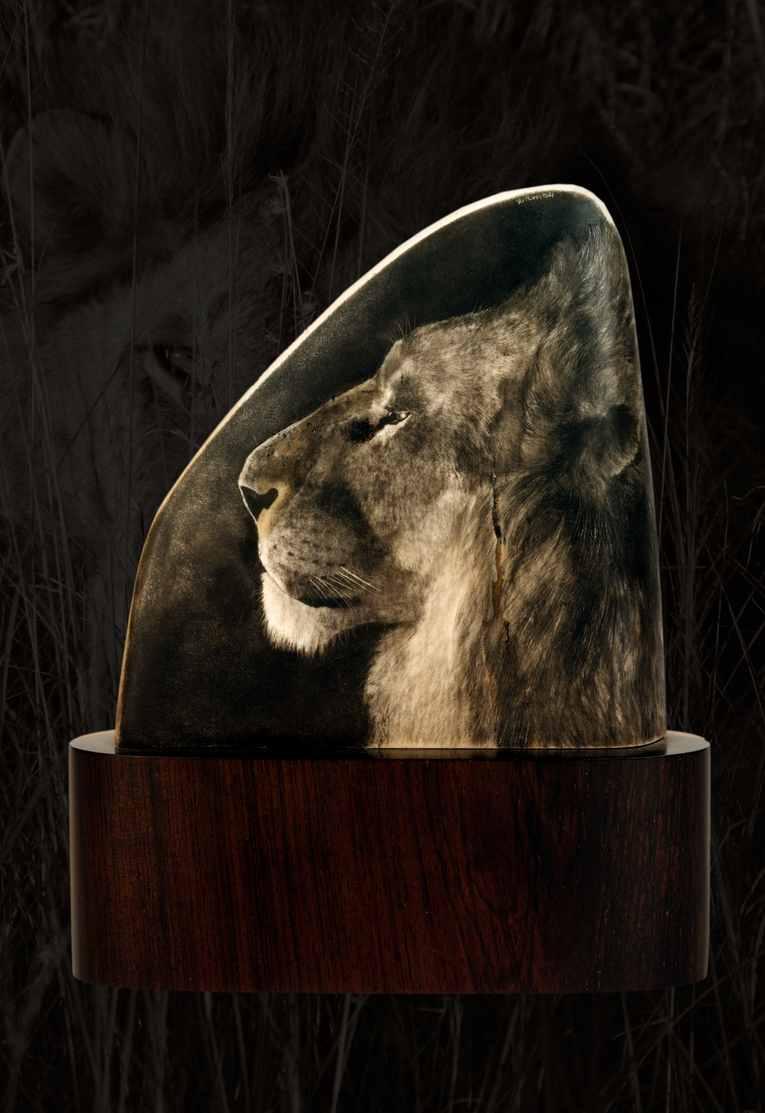 Trompeter & Ritchi Scrimshaw Lion.jpg